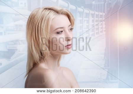 True beauty. Close up of pretty girl looking at the distance while standing against city background