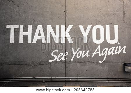 concrete wall with sentence of thank you see you again