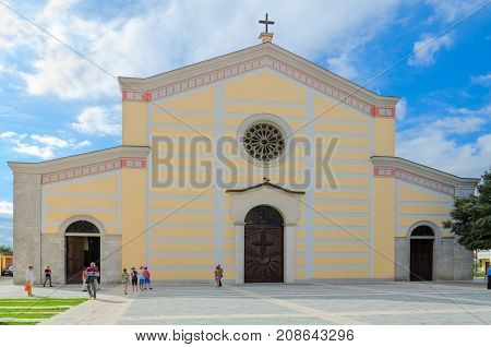 SHKODER ALBANIA - SEPTEMBER 6 2017: Unknown tourists are near St. Stephen's Cathedral Shkoder Albania