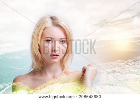 Resting alone. Close up of good looking girl being serious while looking at you and standing against nature background