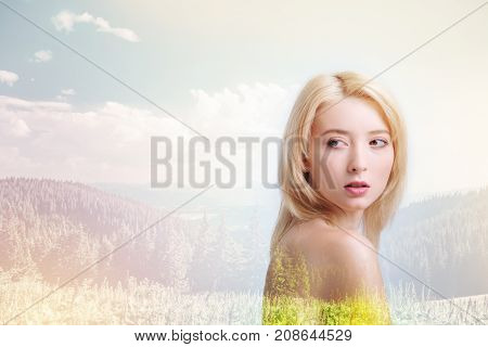 Pleasant time. Professional young model being photographed against nature background while looking away