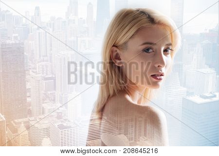 Beauty never fading. Close up of young model expressing calmness while being photographed against city background