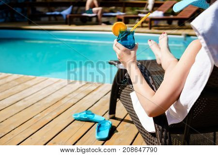 Relaxing Woman Near Luxury Swimming Pool.