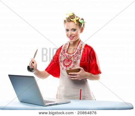 Woman Is Cooking With The Recipe On A Laptop