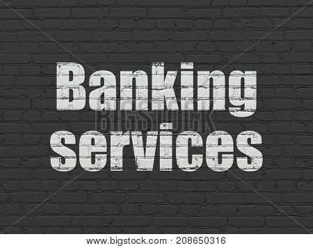 Money concept: Painted white text Banking Services on Black Brick wall background