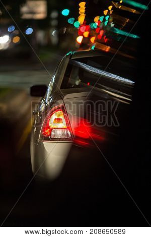 Night road traffic in a big city (shallow DOF)