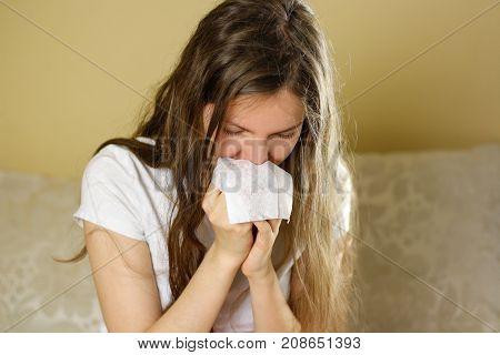 Girl Blowing His Nose Into A White Handkerchief. Runny Nose. Closeup