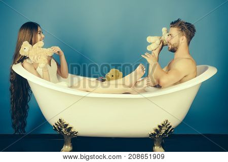 Man In Bathtub Near Girl With Long Hair.