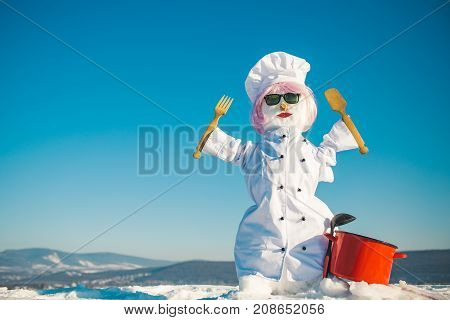 Snowman Cook With Wooden Spoon And Fork.