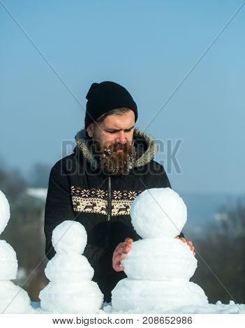 New Year Guy On Blue Sky With Snow Figure.