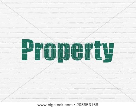 Business concept: Painted green text Property on White Brick wall background