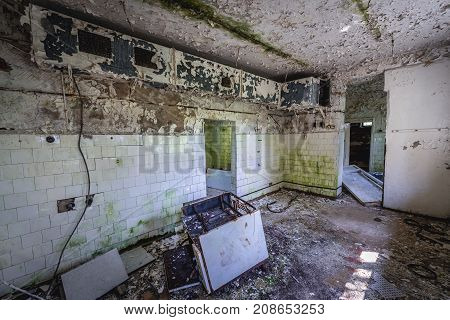 Old oven in kitchen of abandoned preschool in former Soviet military town Skrunda-1 in Latvia