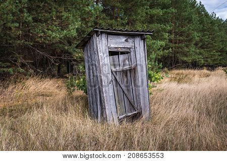 Small privy in abandoned Masheve settlement Chernobyl Exclusion Zone Ukraine