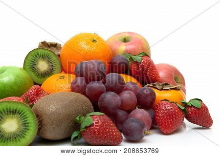 fresh fruits and berries on a white background. horizontal photo.