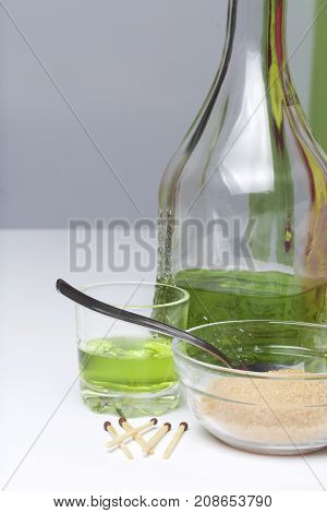 Absinthe Is Green. In A Bottle And Poured Into Glasses. Brown Sugar For Caramelization Of A Drink An
