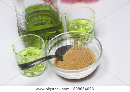 Absinthe Is Green. In A Bottle And Poured Into Glasses. Brown Sugar For Caramelizing The Drink. On A