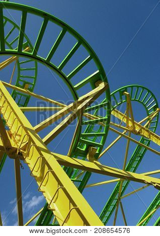 Close up of a small roller coaster in a fairground