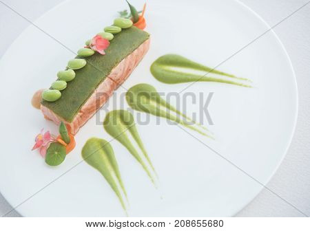 Grilled salmon with peas served on a plate. Gourmet seafood