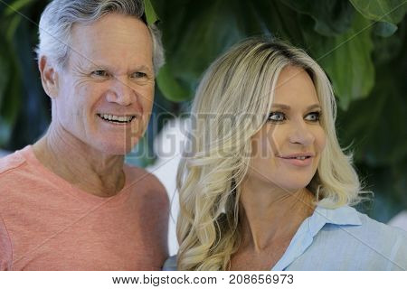 Handsome Man With Beautiful Younger Wife Smiling