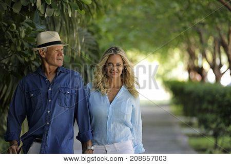 Trending Mature Couple Walking Down The Street