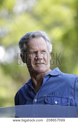 Mature Man Getting Out Of A Car