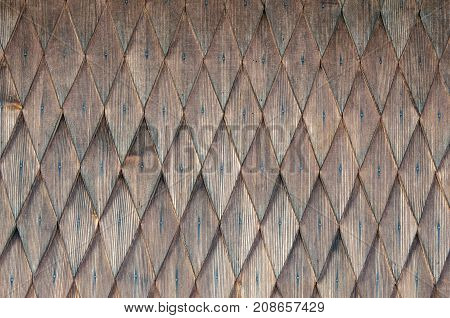 Background of successive rows of wooden rhombuses. Pattern of geometric figures of rhombus. Blank wooden background. Wood texture. Background from a nature wooden.