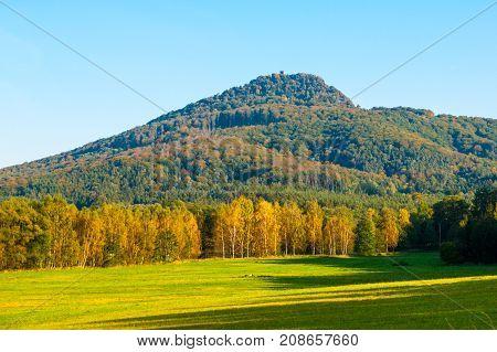 Ralsko mountain on sunny autumn day. Northern Bohemia, Czech Republic.