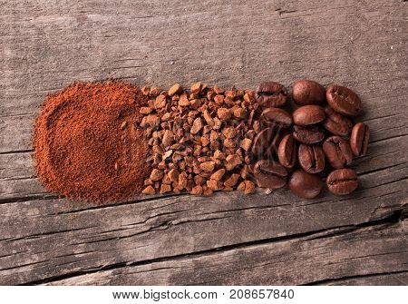 Grains ground coffee and instant coffee on wooden table. Top view