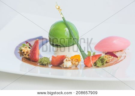 Green apple ice cream sorbet with pieces of fruits