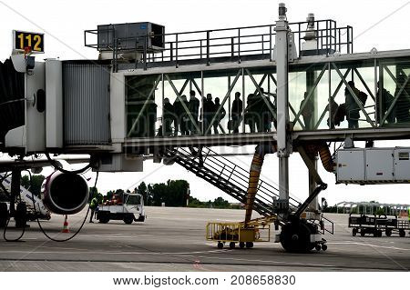 Passengers Boarding On Airplane