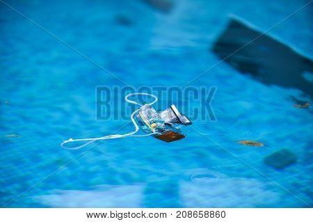 Underwater Photo Camera Housing Floating On Water