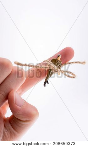 Man Figure Tied To Hand Finger