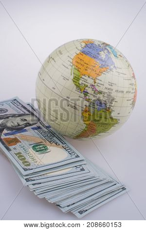 American Dollar Banknotes By The Side Of A Model Globe