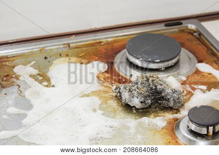 The cleaning of the kitchen. Very dirty gas stove