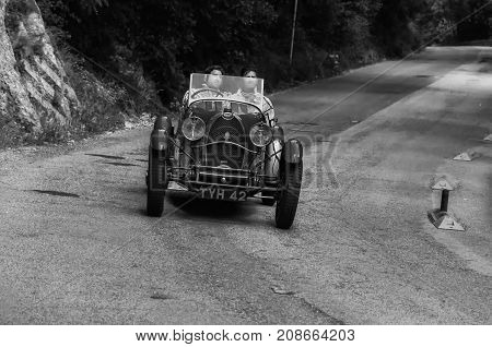 GOLA DEL FURLO, ITALY - MAY 19: BUGATTI Type 40 1927 on an old racing car in rally Mille Miglia 2017 the famous italian historical race (1927-1957) on May 19 2017