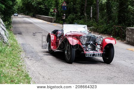 GOLA DEL FURLO, ITALY - ASTON MARTIN INTERNATIONAL 1934 on an old racing car in rally Mille Miglia 2017 the famous italian historical race (1927-1957) on May 19 2017