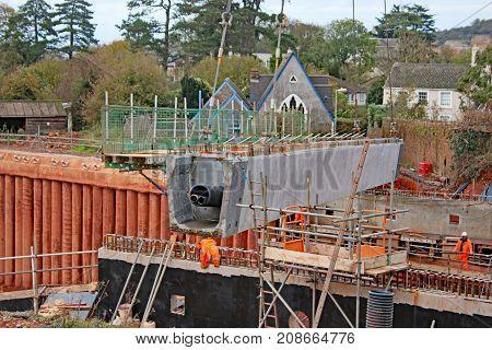crane laying concrete beam for a new bridge