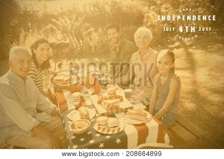 Computer graphic image of happy 4th of july text against happy family having a picnic