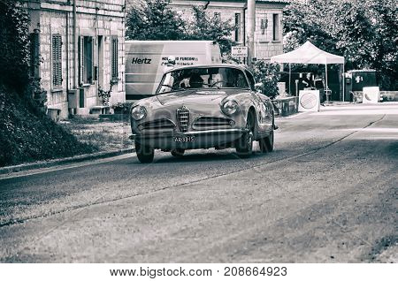GOLA DEL FURLO, ITALY - MAY 19: ALFA ROMEO 1900 C SUPER SPRINT TOURING 1956 on an old racing car in rally Mille Miglia 2017 the famous italian historical race (1927-1957) on May 19 2017