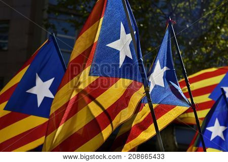 some estelada, the catalan pro-independence flag, against the sky, with a retro effect