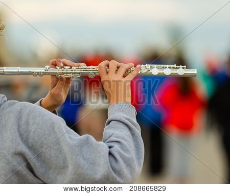 the hands of a flute player at rehearsal