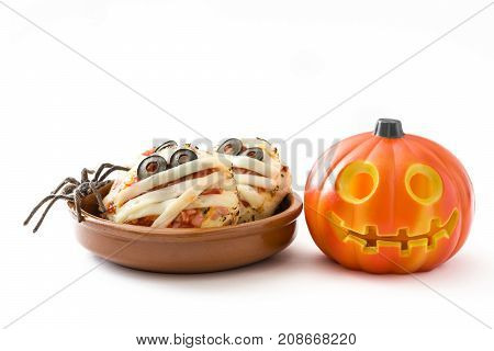 Halloween mummies mini pizzas and halloween pumpkin isolated on white background