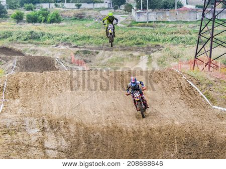 Extreme Sport Motocross. The Athlete Takes Off On A Motorcycle On A Springboard.