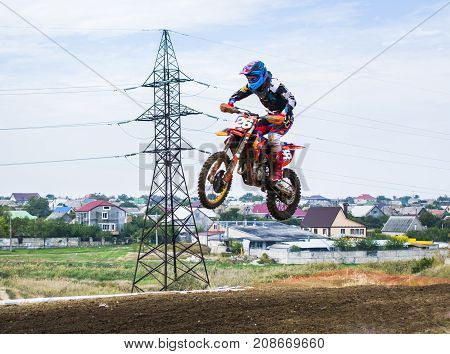 Extreme Sport Motocross. The Athlete Takes Off On A Motorcycle On A Springboard. Very High Jump Jump