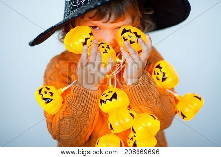 Little Kid With Halloween Decorations