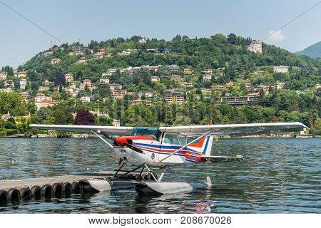 Como Italy - May 27 2016: The seaplane Cessna 172N Skyhawk 100 II docking on at water aerodrome of Como lake in Como City Italy.
