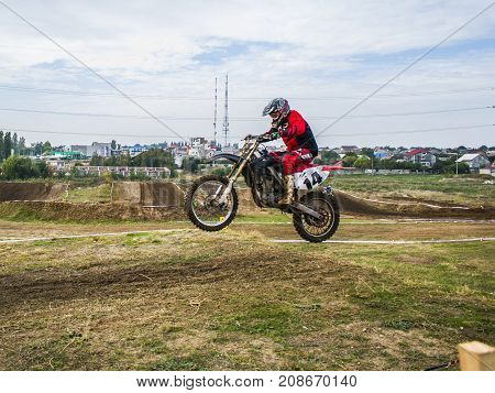 Extreme Sport Motocross. The Athlete Takes Off On A Motorcycle On A Springboard. Competition In The