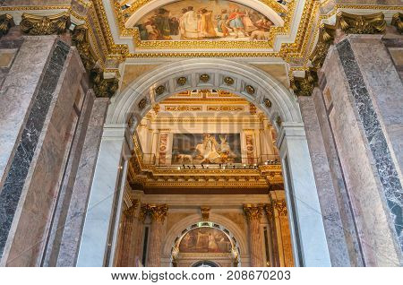 ST PETERSBURG RUSSIA - AUGUST 15 2017. Interior of the St Isaac Cathedral in St Petersburg Russia. Decorated ceiling and pink marble walls