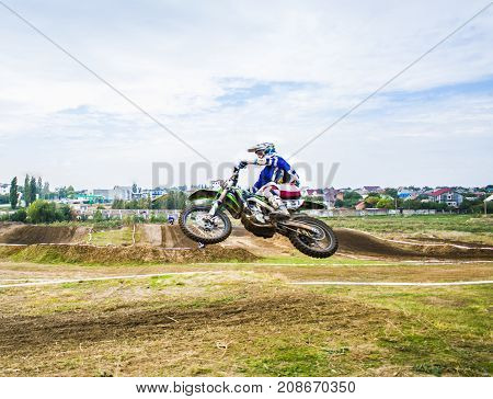 Extreme Sport Motocross. The Athlete Takes Off On A Motorcycle On A Springboard. Athlete Flies Sidew