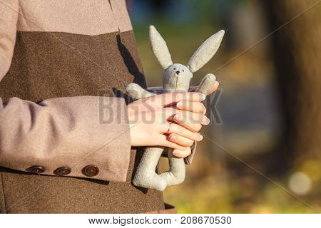 girl with white rabbit in his hand